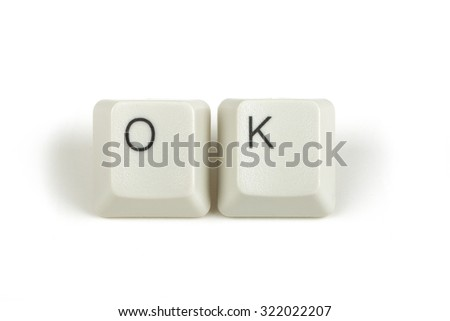 ok text from scattered keyboard keys isolated on white background