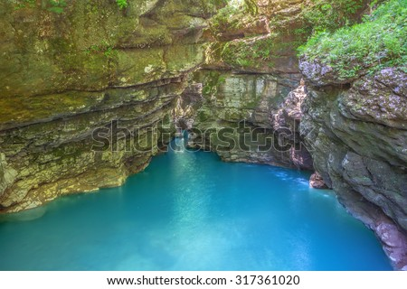 Okatse canyon (Georgia): picturesque rocks hang out over the azure river. - stock photo