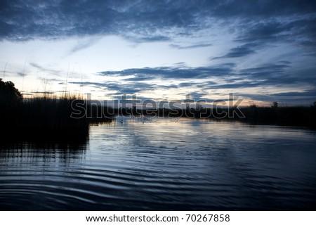 Okavango delta in botswana and sunset - Moremi Reserve - stock photo