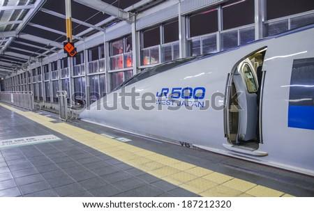 OKAYAMA - DEC 26 : Shinkansen bullet train at Okayama railway station in December 26,2013 Okayama, Japan. Shinkansen is world's busiest high-speed railway operated by four Japan Railways companies. - stock photo