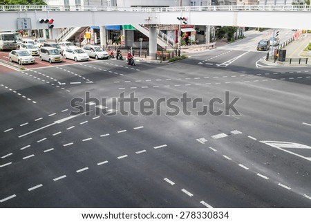OKINAWA, JAPAN - MARCH 19, 2013: Cars waiting for green light on the street.   - stock photo