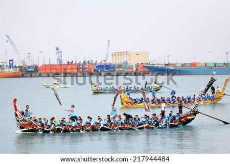 OKINAWA,JAPAN - MAY 05, 2012 IN NAHA,OKINAWA,JAPAN okinawa Naha Hari Festival is held from May 3 to May 5 every year at Tomari port in Naha city and the Dragon Boat Race is held on May 5 - stock photo