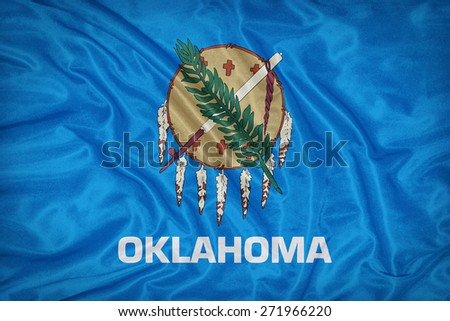 Oklahoma flag on fabric texture,retro vintage style - stock photo