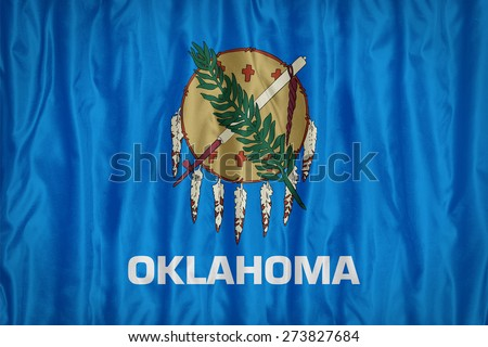 Oklahoma flag pattern with a peace on fabric texture,retro vintage style - stock photo