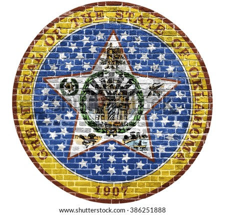 Oklahoma Seal US flag painted on old vintage brick wall - stock photo