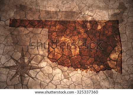 Oklahoma state map on vintage usa map, crack paper background - stock photo