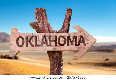 Oklahoma wooden sign with a desert background - stock photo