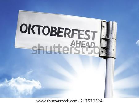 Oktoberfest Ahead written on the road sign - stock photo