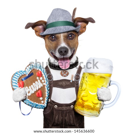 oktoberfest dog with beer mug and gingerbread heart, smiling happy - stock photo