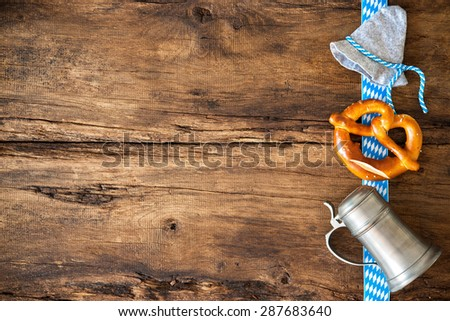 Oktoberfest festival background with beer mug, pretzel and Bavarian hat - stock photo