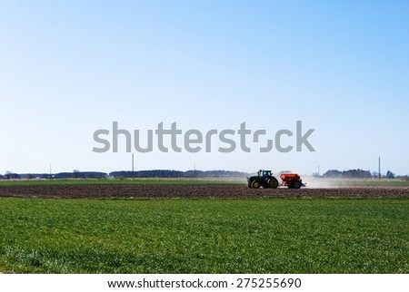 OLAND, SWEDEN - APRIL 21: Springtime with farmers tractor work at a field at the swedish island Oland. Photo taken on April 21 2015 at the island Oland in Sweden.