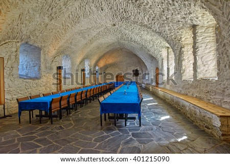 OLAVINLINNA CASTLE, SAVONLINNA FINLAND - CIRCA AUGUST 2015: Empty Royal Eatery (Canteen) in a the Olofsborg Castle in daylight - stock photo