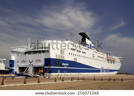 OLBIA, SARDINIA, ITALY - MAY 10, 2008: Tirrenia ferry at the pier in the harbor. Olbia is the main ferry port on the island, illustrative editorial.