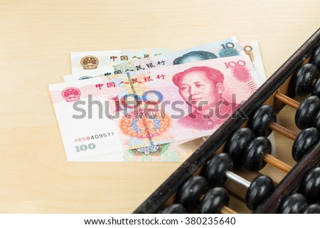 Old abacus with chinese money yuan banknote