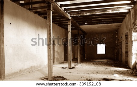Old abandonated industrial building on sepia tone - stock photo