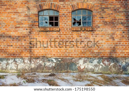 Old, abandoned and forgotten building of red brick - stock photo
