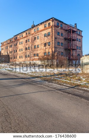 Old, abandoned and forgotten factory of red brick - stock photo