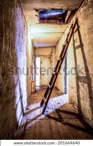 Old abandoned attic with ladder leads to roof exit, HDR picture