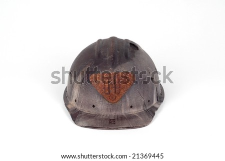 old abandoned bakelite helmet of a miner with rusted light-plug isolated on white - stock photo