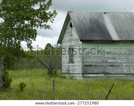 Old abandoned barn in a field, Komarno, Manitoba, Canada - stock photo