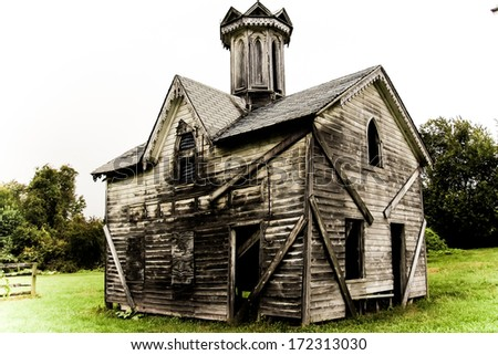 Old Abandoned Building 3. The facade of a small abandoned church or similar historic structure in a rural setting. - stock photo