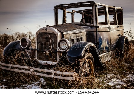 old abandoned car edited in hdr - stock photo
