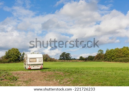 Old, abandoned caravan in a field in Somerset, England.