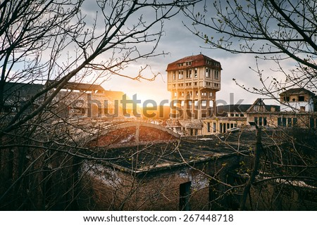 Old abandoned coal mine buildings - stock photo