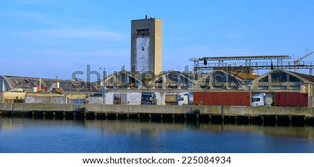 Old abandoned factories along the dock of ravenna, Italy - stock photo