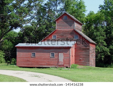 old abandoned farm buildings red garage granary - stock photo