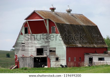 old abandoned farm buildings red white - stock photo