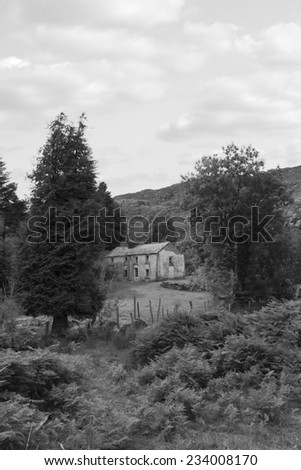 old abandoned farmhouse in the mountains of county Kerry Ireland in black and white - stock photo
