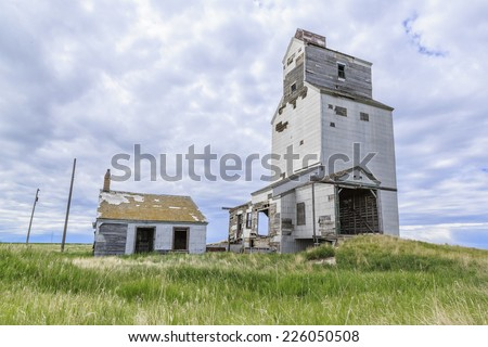 Old abandoned grain elevator in the ghost town of Dankin, Saskatchewan, Canada. - stock photo