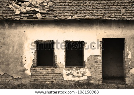 Old abandoned house entrance in sepia - stock photo