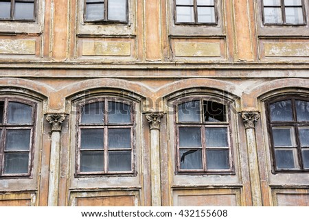 Old abandoned house in Banska Stiavnica, Slovak republic. Architectural theme. Ancient house. Ruin house. Cracked wall. Architectural element. Impaired statics. Old architecture. Broken windows. - stock photo