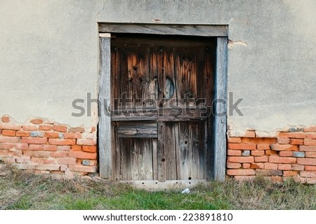 Old abandoned house with wooden door - stock photo