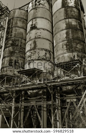 Old abandoned industrial building of cement plant Chernobyl. Ruins of an old factory. Rubbish, rusty metal is broken equipment of cement plant. Element for apocalyptic design, retro, stalker. Trash