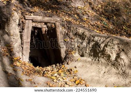Old abandoned mine entrance - stock photo
