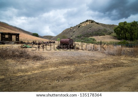 Old abandoned mining town scrap left behind - stock photo