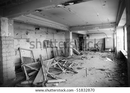 Old abandoned office in a state of destruction (black and white) - stock photo