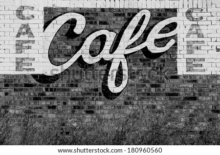 Old abandoned restaurant or cafe sign painted on a wall along Route 66 in northern Texas - stock photo