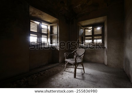 old abandoned room with chair - stock photo
