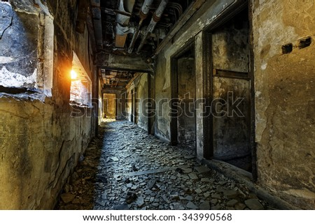 Old abandoned ruin factory damage building inside - stock photo