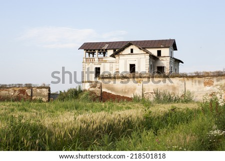 Old, abandoned, ruined house in the field  - stock photo