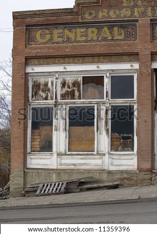 old abandoned rural general store front - stock photo