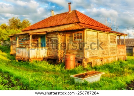 Old abandoned rural house in russian countryside - stock photo