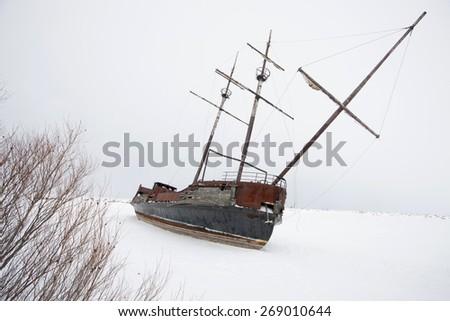 Old Abandoned rusty Sailboat on Lake Ontario Canada - stock photo