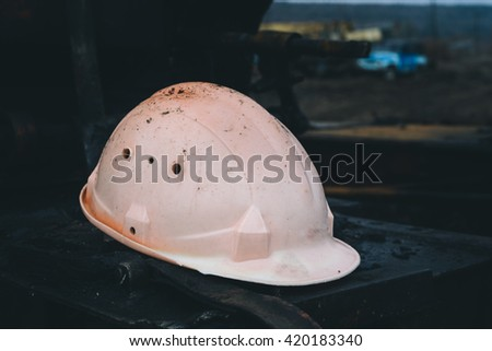 old abandoned safety helmet on a black background - stock photo