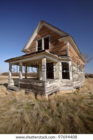 Old abandoned Saskatchewan farmhouse - stock photo