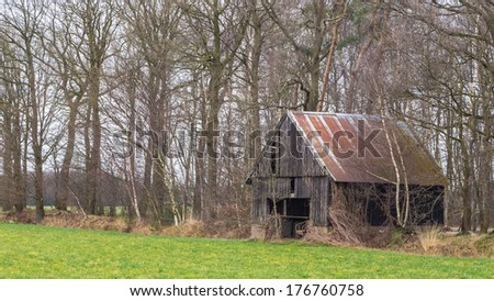Old abandoned shed in a field in the Netherlands - stock photo
